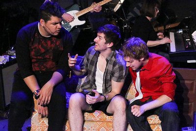 "Gabe Taylor, Brendan Ochs (as Will), and Jeremy Hyatt, singing ""She's a Rebel,"" in New Line Theatre's AMERICAN IDIOT. Photo credit: Jill Ritter Lindberg."