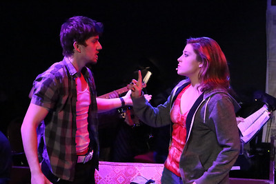 "Brendan Ochs as Will and Larissa White as Heather, singing ""Too Much Too Soon,"" in New Line Theatre's AMERICAN IDIOT. Photo credit: Jill Ritter Lindberg."