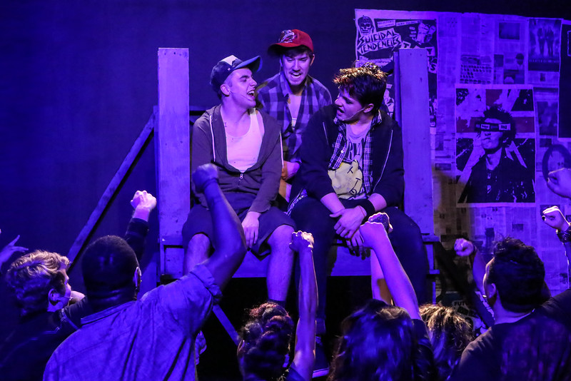 "Tunny (Frederick Rice), Will (Brendan Ochs), and Johnny (Evan Fornachon), on the roof of the 7-11, singing ""City of the Damned,"" in New Line Theatre's AMERICAN IDIOT. Photo credit: Jill Ritter Lindberg."