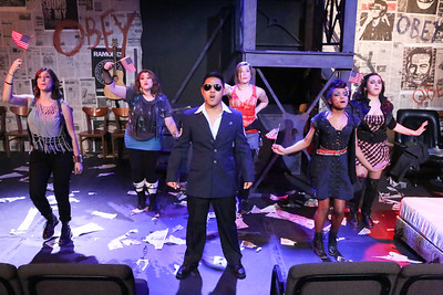 "Favorite Son (Kevin Corpuz) and his back-up girls (Ariel Saul, Tanya Sapp, Larissa White, Cameisha Cotton, Sicily Mathenia), singing ""Favorite Son,"""" in New Line Theatre's AMERICAN IDIOT. Photo credit: Jill Ritter Lindberg."