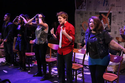 "The cast singing ""East 12th Street,"" in New Line Theatre's AMERICAN IDIOT. Left to right, Kevin Corpuz, Cameisha Cotton, Ariel Saul, Jeremy Hyatt, and Tanya Sapp. Photo credit: Jill Ritter Lindberg."