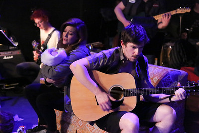 "Larissa White as Heather and Brendan Ochs as Will, singing ""Give Me Novacaine"" in New Line Theatre's AMERICAN IDIOT. Photo credit: Jill Ritter Lindberg."