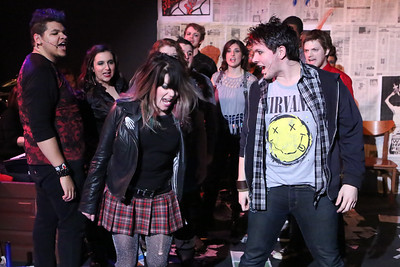 "The cast singing ""She's a Rebel"" -- in front, Sarah Porter as Whatsername and Evan Fornachon as Johnny, in New Line Theatre's AMERICAN IDIOT. Photo credit: Jill Ritter Lindberg."