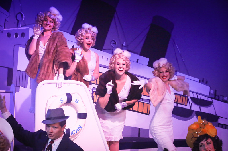 "Reno's Angels -- Alyssa Wolf, Sara Rae Womack, Michelle Sauer, Larissa White -- singing ""Bon Voyage"" in ANYTHING GOES, New Line Theatre, 2018. Photo credit: Jill Ritter Lindberg."
