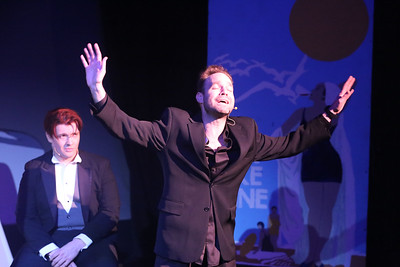 """Aaron Allen as Moonface Martin (front) singing """"Be Like the Bluebird,"""" with  Evan Fornachon as Billy, in ANYTHING GOES, New Line Theatre, 2018. Photo credit: Jill Ritter Lindberg."""