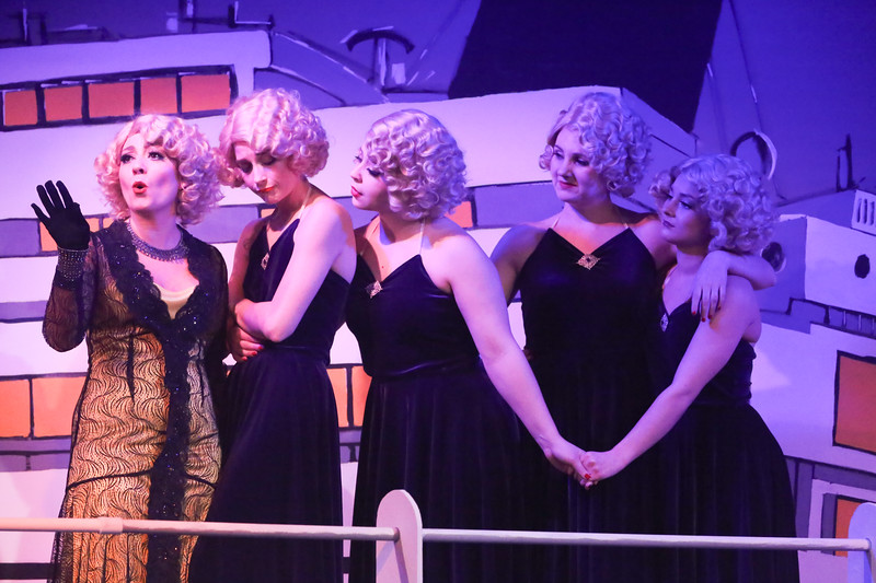 "Sarah Porter as Reno, and her Angels -- Larissa White, Sara Rae Womack, Michelle Sauer, and Alyssa Wolf, singing ""Take Me Back to Manhattan"" in ANYTHING GOES, New Line Theatre, 2018. Photo credit: Jill Ritter Lindberg."