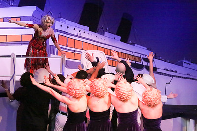 """Sarah Porter as Reno, and the company, singing """"Blow, Gabriel, Blow"""" in ANYTHING GOES, New Line Theatre, 2018. Photo credit: Jill Ritter Lindberg."""