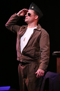 """Jeffrey M. Wright as Paul Tibbets, singing """"Stars and Stripes,"""" in New Line Theatre's ATOMIC. Photo credit: Jill Ritter Lindberg."""
