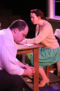 """Zachary Allen Farmer as Leo Szilard and Ann Hier as Trude Weiss, singing """"Where is Home?"""",  in New Line Theatre's ATOMIC. Photo credit: Jill Ritter Lindberg."""