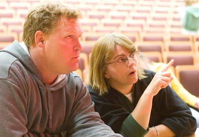 "Stage manager Scott Montavon (left) and director Tracey Busby discuss stage design prior to a rehearsal of the play ""Annie Jr.""  at Sycamore High School on Thursday, September 16, 2010."
