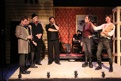 """John Sparger as Andrew Jackson (far right), being censured by Washington politicians (left to right, Mike Dowdy, BC Stands, Zacahary Allen Farmer, Nicholas Kelly, Brian Claussen) in New Line Theatre's """"Bloody Bloody Andrew Jackson,"""" 2012. Photo credit: Jill Ritter Lindberg."""