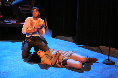 """John Sparger as Andrew Jackson, adopts the child of an Indian woman (Sarah Porter) he's killed, in New Line Theatre's """"Bloody Bloody Andrew Jackson,"""" 2012. Photo credit: Jill Ritter Lindberg."""