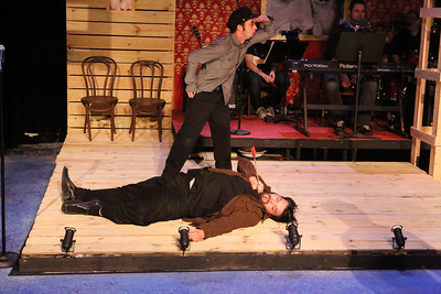 """The Indians attack! Nicholas Kelly (dead on the ground) and Todd Micali in New Line Theatre's """"Bloody Bloody Andrew Jackson,"""" 2012. Photo credit: Jill Ritter Lindberg."""