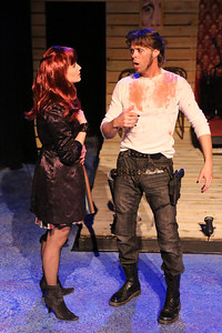 """Taylor Pietz as Rachel Jackson confronting John Sparger as Andrew Jackson about his decision to run again, in New Line Theatre's """"Bloody Bloody Andrew Jackson,"""" 2012. Photo credit: Jill Ritter Lindberg."""