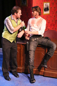 """MIke Dowdy delivers champagne to the Oval Office for Andrew Jackson (John Sparger), in New Line Theatre's """"Bloody Bloody Andrew Jackson,"""" 2012. Photo credit: Jill Ritter Lindberg."""