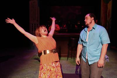 "Kimi Short as One True Love and Zachary Allen Farmer as Charles Bukowski, singing the drunken ""Chaser of My Heart,"" in New Line Theatre's ""Bukowsical,"" 2013. Photo credit: Jill Ritter Lindberg."