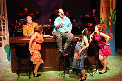 """Joel Hackbarth (in back) as the narrator, Kimi Short as One True Love, Zachary Allen Farmer as Charles Bukowski, Chrissy Young as Frances, and Marcy Wiegert as Bukowski's first publisher, singing """"Love is a Dog from Hell,"""" in New Line Theatre's """"Bukowsical,"""" 2013. Photo credit: Jill Ritter Lindberg"""