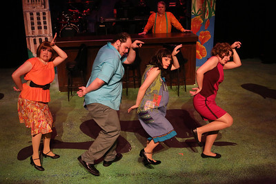 """Kimi Short as One True Love, Zachary Allen Farmer as Charles Bukowski, Chrissy Young as Frances, and Marcy Wiegert as Bukowski's first publisher, singing """"Love is a Dog from Hell"""" (with Joel Hackbarth in back as the narrator), in New Line Theatre's """"Bukowsical,"""" 2013. Photo credit: Jill Ritter Lindberg."""