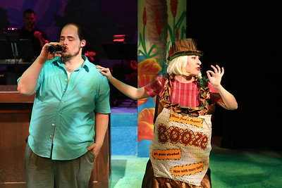 """Zachary Allen Farmer as Charles Bukowski, with Marcy Wiegert as Sweet Lady Booze, singing """"Take Me,"""" in New Line Theatre's """"Bukowsical,"""" 2013. Photo credit: Jill Ritter Lindberg."""