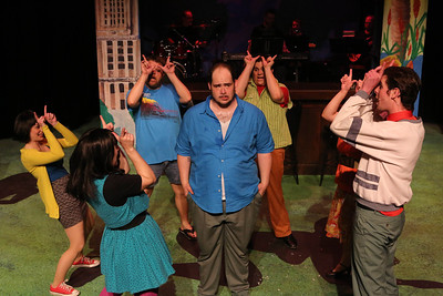 """Zachary Allen Farmer (center) as Charles Bukowski, surrounded by the cast singing """"12 Steps of Love,"""" in New Line Theatre's """"Bukowsical,"""" 2013. Photo credit: Jill Ritter Lindberg"""