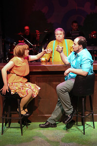 """Kimi Short as One True Love and Zachary Allen Farmer as Charles Bukowski (with Joel Hackbarth behind the bar), singing the drunken """"Chaser of My Heart,"""" in New Line Theatre's """"Bukowsical,"""" 2013. Photo credit: Jill Ritter Lindberg."""