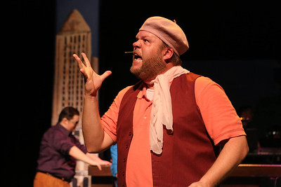 """Nicholas Kelly as French film director Barbet Schroeder, singing, """"Through a Glass, Barfly,"""" in New Line Theatre's """"Bukowsical,"""" 2013. Photo credit: Jill Ritter Lindberg"""