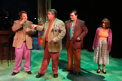 """Nicholas Kelly as William Faulkner, Joel Hackbarth as Tennessee Williams, Christopher Strawhun as William S. Burroughs, and Chrissy Young as Sylvia Plath, singing """"Get Down, Get Dark, Get Dirty,"""" in New Line Theatre's """"Bukowsical,"""" 2013. Photo credit: Jill Ritter Lindberg."""