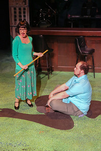 """Chrissy Young as an abusive teacher and Zachary Allen Farmer as a young Charles Bukowski, singing """"Art is Pain,"""" in New Line Theatre's """"Bukowsical,"""" 2013. Photo credit: Jill Ritter Lindberg."""