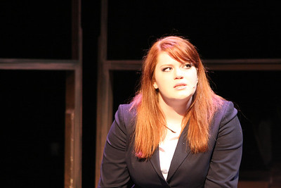 "Nadia (Charlotte Byrd) sings ""A Quiet Night at Home,"" in New Line Theatre's bare. Photo credit: Jill Ritter"