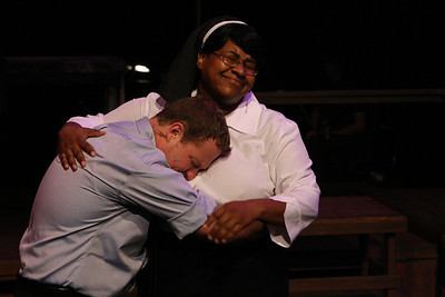 "Peter (Mike Dowdy) seeks comfort from Sister Chantelle (Nikki Glenn) in New Line Theatre's ""bare."" Photo credit: Jill Ritter"
