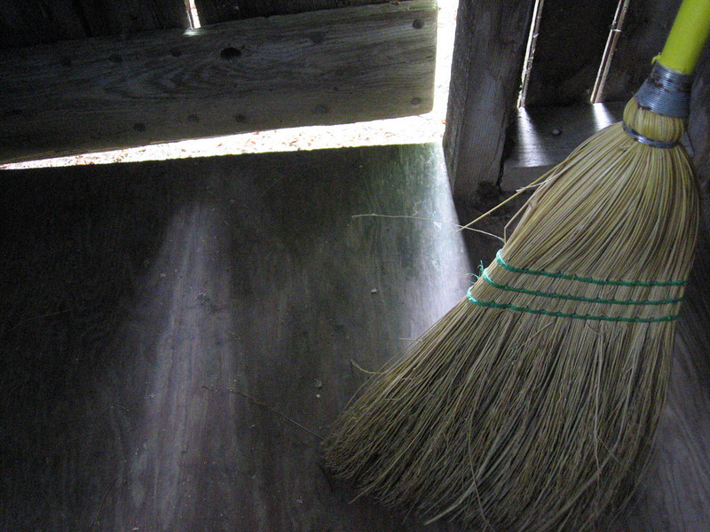 Still life with outhouse broom