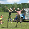 Greg and Kyla dance together on stilts
