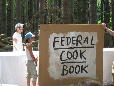 The first act of our pageant:  the Federal Cookbook!  With such recipes as:  Democracy Appetizer!  It is a pancake, served very hot with lots of syrup, just before a four-year fast.