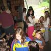 Kelly with lots of volunteer children