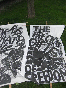 "I carried this Precious Gift of Freedom banner in one of the parades, and I got heckled.  Someone yelled at me ""When was the last time you stood up to defend that freedom?!""  I responded, it got them madder, asdf.  Anyway, whose freedom are we defending?  It reminds me of a Get Your War On comic."