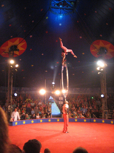 This act was the highlight of the night, a young man who balanced the whole apparatus on his head while a young woman slithered around it, way up in the air.  So cool!