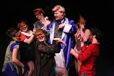 The Revelers prepare Mr. Rich (Zachary Allen Farmer, center in blue robe) for his big moment, in CELEBRATION, New Line Theatre, 2016. Photo credit: Jill Ritter Lindberg.