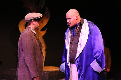 Orphan (Sean Michael, left) stands up to Mr. Rich (Zachary Allen Farmer), in CELEBRATION, New Line Theatre, 2016. Photo credit: Jill Ritter Lindberg.