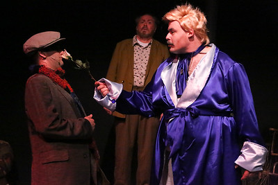 Potemkin (Kent Coffel, in back) watches as Mr. Rich (Zachary Allen Farmer, right) shows Orphan (Sean Michael, left) the flower he's made, in CELEBRATION, New Line Theatre, 2016. Photo credit: Jill Ritter Lindberg.