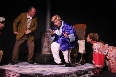 Zachary Allen Farmer as Mr. Rich (in blue, center) experiences an emotion for the first time in a long time, wit Potemkin (Kent Coffel, left) and Angel (Larissa White) as witnesses, in CELEBRATION, New Line Theatre, 2016. Photo credit: Jill Ritter Lindberg.