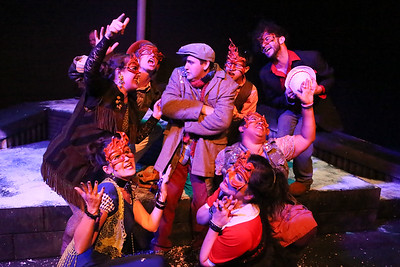 """The Revelers attack Orphan (Sean Michael, center) in """"Orphan in the Storm,"""" in CELEBRATION, New Line Theatre, 2016. Photo credit: Jill Ritter Lindberg."""