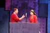 """Mike Dowdy as Baldwin Blandish and Taylor Pietz as Allison Vernon-Williams, on the actual radio, in New Line Theatre's """"Cry-Baby."""" Photo credit: Jill Ritter Lindberg."""