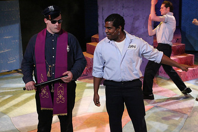 "Zachary Allen Farmer as Father Officer O'Brien and Ari D. Scott as Dupree, singing ""A Little Upset,"" in New Line Theatre's ""Cry-Baby."" Photo credit: Jill Ritter Lindberg."