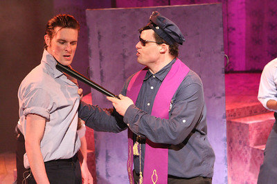"Ryan Foizey as Wade ""Cry-Baby"" Walker and Zachary Allen Farmer as Father Officer O'Brien, singing ""A Little Upset,"" in New Line Theatre's ""Cry-Baby."" Photo credit: Jill Ritter Lindberg."