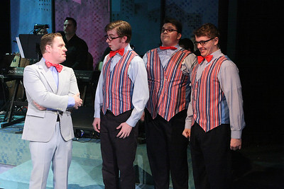 "Mike Dowdy as Baldwin Blandish, and The Whiffles (Devon A.A. Norris, Christopher Strawhun, Evan Fornachon, in New Line Theatre's ""Cry-Baby."" Photo credit: Jill Ritter Lindberg."