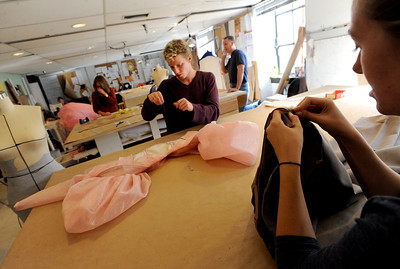 "David Smithey, center, and Hayley Gocha, work on costumes for the show, ""14"" in the University of Colorado Theater costume shop. For a video of the costume shop, go to www.dailycamera.com Cliff Grassmick / October 18, 2011"