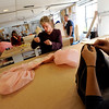 "David Smithey, center, and Hayley Gocha, work on costumes for the show, ""14"" in the University of Colorado Theater costume shop.<br /> For a video of the costume shop, go to  <a href=""http://www.dailycamera.com"">http://www.dailycamera.com</a><br /> Cliff Grassmick / October 18, 2011"