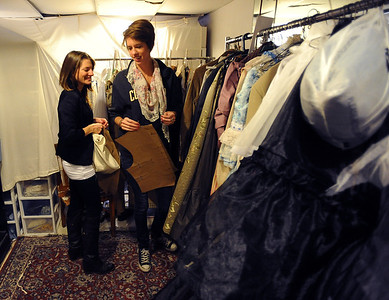Deirdre Graham, left, and Sara Hildebrand, look through some of the finished costumes during class. University of Colorado students do class work in the costume technology class on Friday.  For more photos and a video, go to www.dailycamera.com. Cliff Grassmick / October 21, 2011