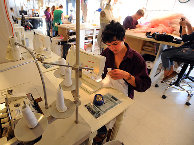 Jackie Kreiger sews a costume on Wednesday at the University of Colorado Theater costume shop. For a video of the costume shop, go to www.dailycamera.com Cliff Grassmick / October 18, 2011