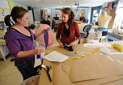Stacey Ryan, left, gets help with a garment from shop manager, Brenda King, at the University of Colorado Theater costume shop. For a video of the costume shop, go to www.dailycamera.com Cliff Grassmick / October 18, 2011